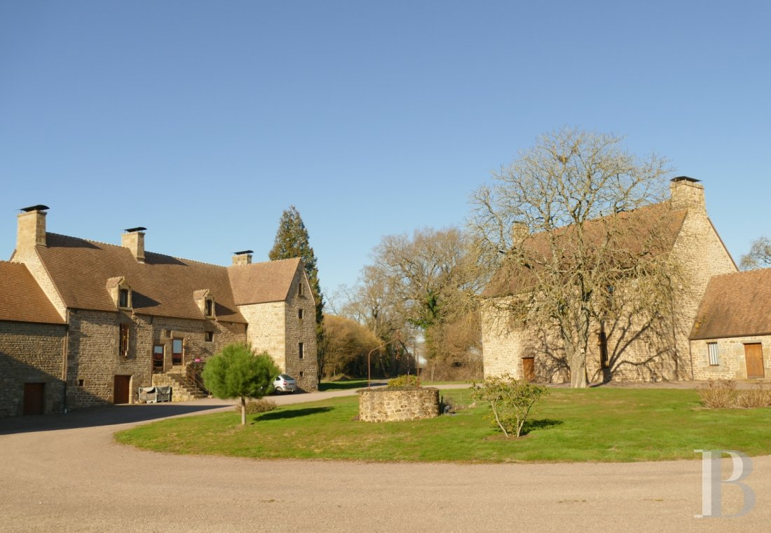 "Manors for sale - lower-normandy - A 14th century manor house, with its 15th century ""gendarmerie"" and 3.5 ha, on the outskirts of Swiss Normandy in the French department of Orne"