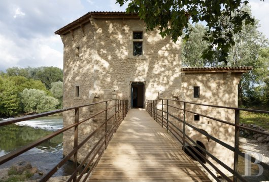 fA former fortified mill transformed into a family home  on the banks of the Hérault, between Montpellier and Béziers - photo N°3