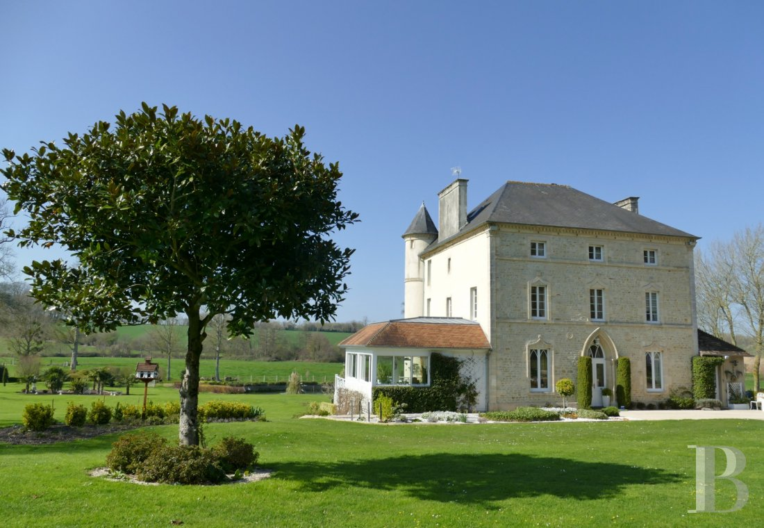 Manors for sale - lower-normandy - A 19th century manor house and its outbuildings in wooded parklands  11 km from the D-Day Landing beaches in the French department of Calvados