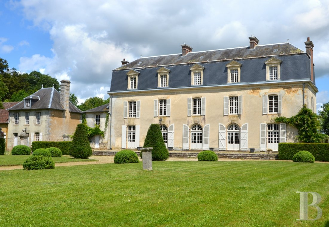 Castles / chateaux for sale - lower-normandy - An 18th century chateau, its chapel and its outbuildings in an undulating setting, with almost 14 ha of woods and grasslands, to the south of the Normandy-Maine Regional Nature Park