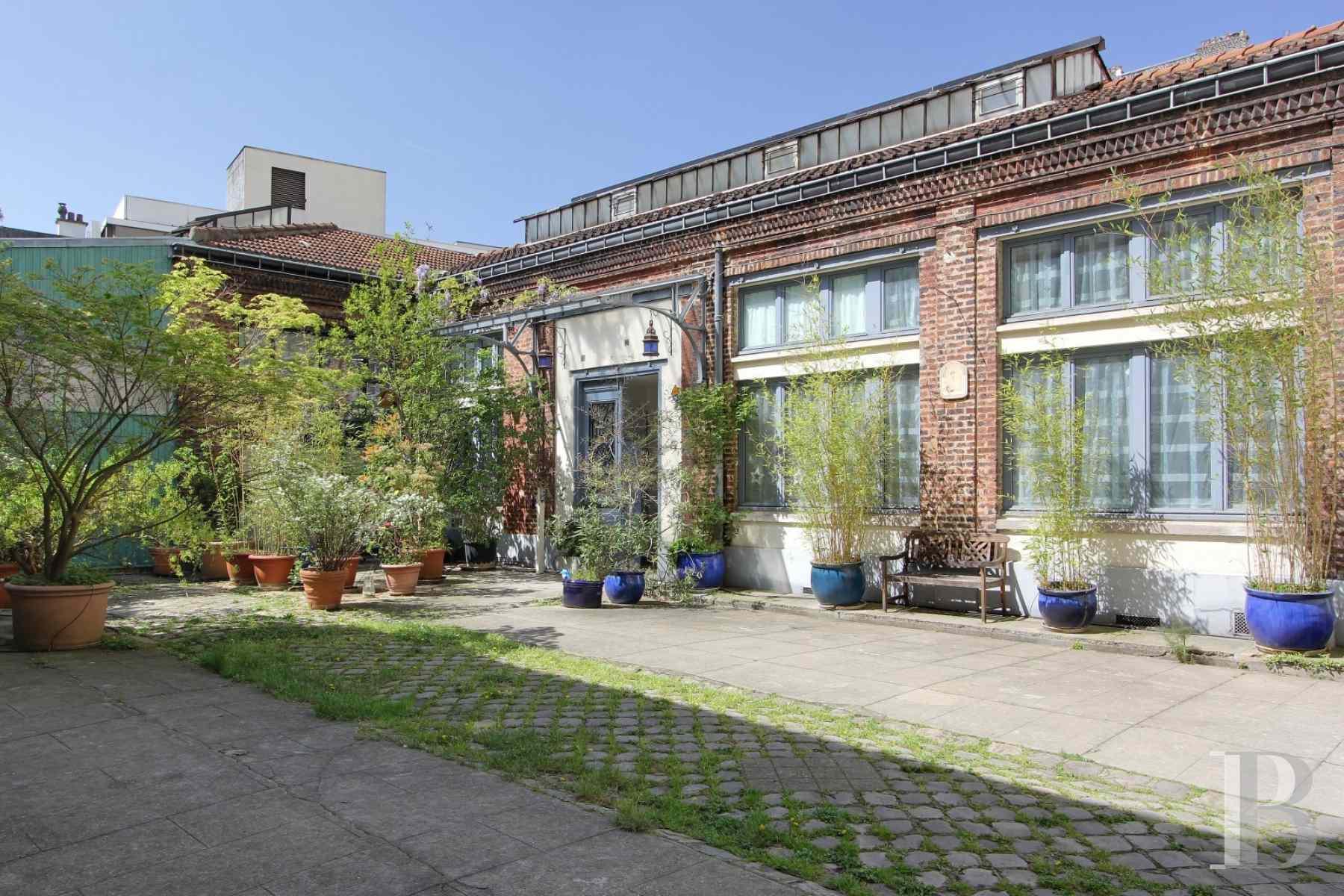 Nation dans une ancienne miroiterie maison de 392 m for Agence immobiliere specialisee terrasse paris