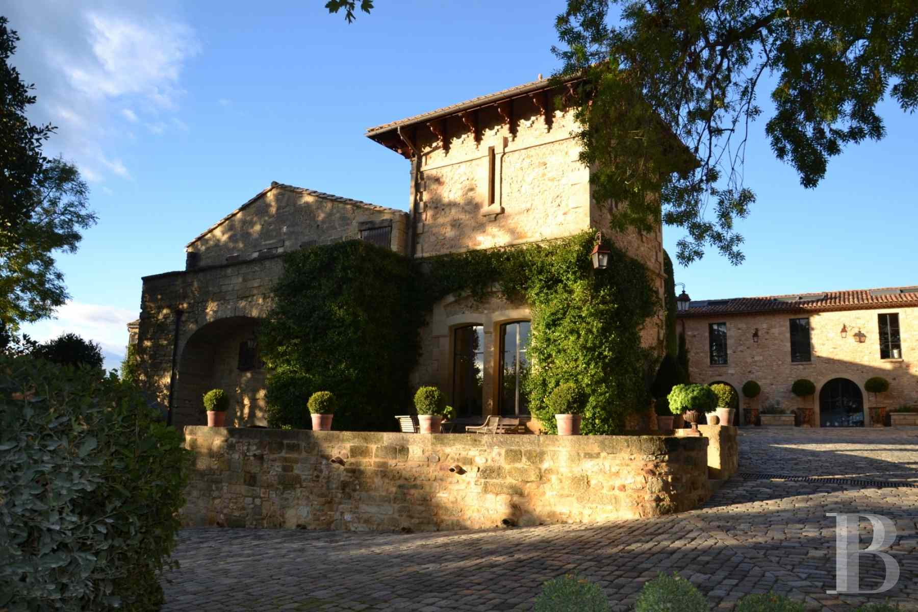 A castle overlooking parklands and countryside on the for French countryside real estate