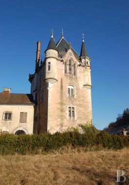 Castles / chateaux for sale - rhones-alps - An imposing, listed village castle with its spas and waterfalls  on the Jura mountain foothills in the Upper Bugey region