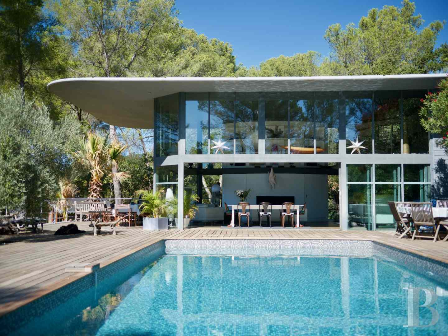 A traditional mas house with a fully glazed contemporary for What does piscine mean in french