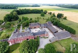 An 18th century chateau, with a farm and 6 ha of wooded parklands, 30 km from Liège, in the Condroz region