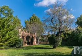 An old mill, transformed into a luxury villa, with a swimming pool  and an exotic garden, near to the village of Santa-Eugènia