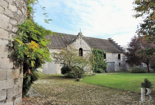 A 16th century farm building, comprising two houses and  outbuildings awaiting renovation, in the area around Namur