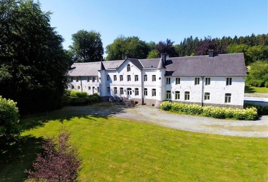 A chateau and its wooded, 42-ha estate  in the Belgian Ardennes region
