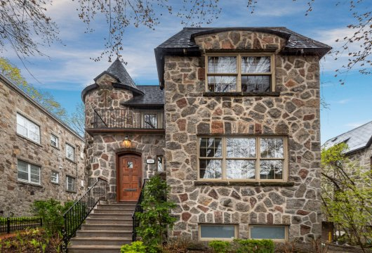 A stone house in a peaceful, wooded street  in Montreal's Outremont district